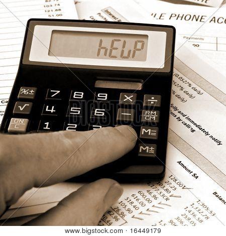 Bills and calculator displaying HELP