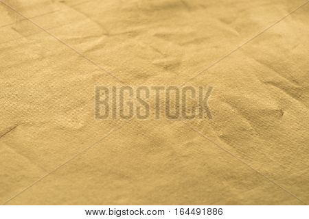 Gold texture with kinks and scratches abstract golden background