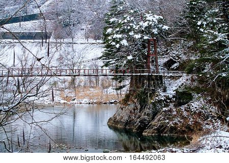 Typical japan landscape with stream water in the river and snow in the winter season JAPAN