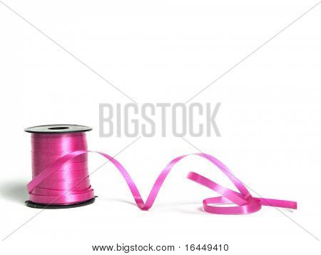 Reel of pink ribbon isolated on white background