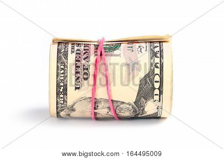rolled into a tube and tied with a rubber band paper notes American dollars as part of the world economic system