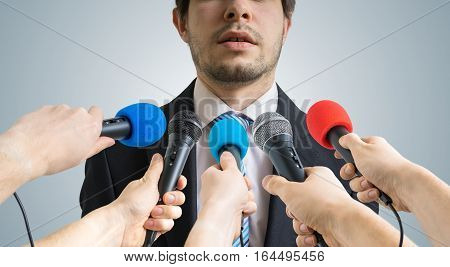 Politician Is Talking Ang Giving Interview To Reporters. Many Mi