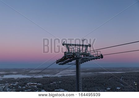 cable way in Finland on early morning sky background