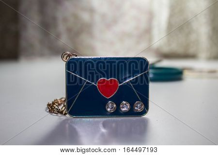 Blue letter with heart in the center