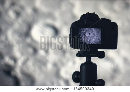 Moon Photography. Camera With Tripod Capturing Moon. Moon Crater Tycho