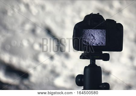 Moon Photography. Camera With Tripod Capturing Moon. Moon Crater Clavius.