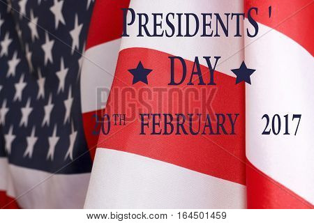 Presidents ' day background. The text of PRESIDENTS ' DAY 20 February 2017 and the US flag.