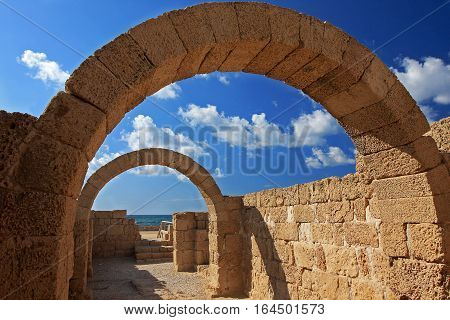 Arches connect two walls in Caesarea, Israel.