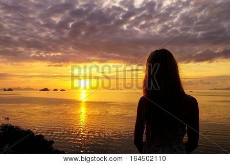 Female Silhouette Watching Sunset Sea View on Samui island, Thailand