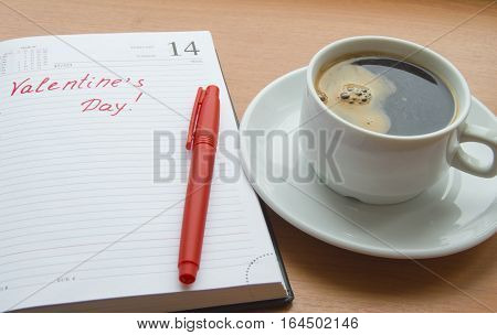 The concept of celebrating Valentine's Day, Cup of coffee, diaries