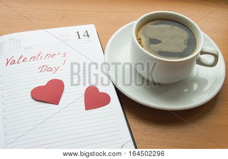 The concept of celebrating Valentine's Day, Cup of coffee, diaries, hearts