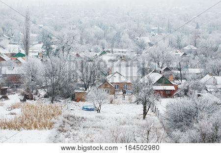 Beautiful rural landscape, village in winter, bird's eye view.