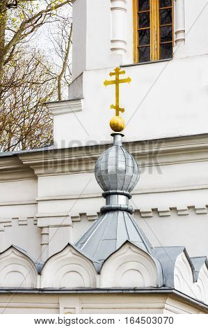 Small orthodox church dome with golden cross in Kaunas. Lithuania.