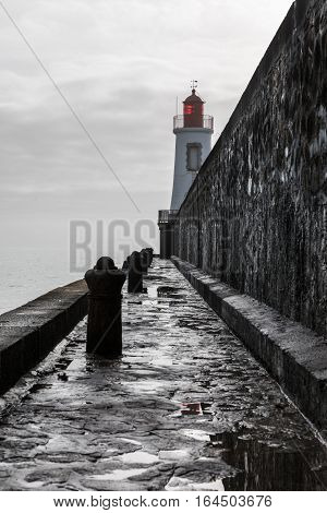 Red lighthouse of la Chaume district of Les Sables d'Olonne in bad weather