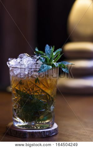 cold tea, crushed ice refreshing cocktail with mint, on the bar