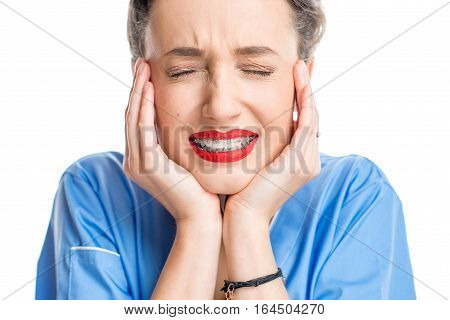 Close up portrait of a woman with tooth braces on the white background. Woman worried about a new smile with braces