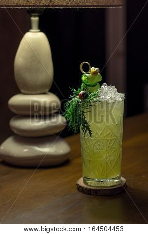 Cold cocktail with cucumber and parsley decorated with bee and ladybug