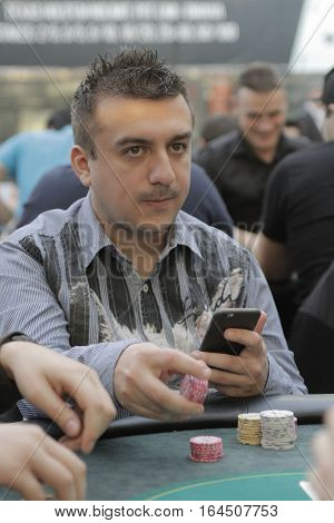 Bucharest Romania 19 December 2015: Mihai Manole former winner of European Poker Championship plays during Winmasters Poker Open festival at World Trade Center in Bucharest capital of Romania for prizes in total of 500000 EUR.