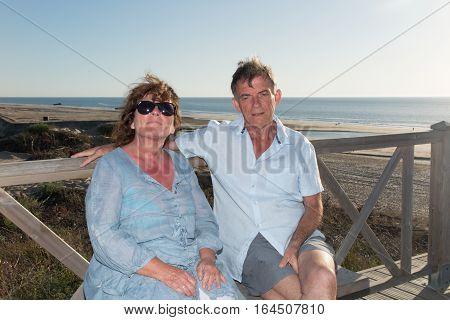 A Senior Retired Couple On The Beach