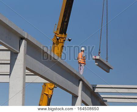 Construction Worker On Concrete Truss