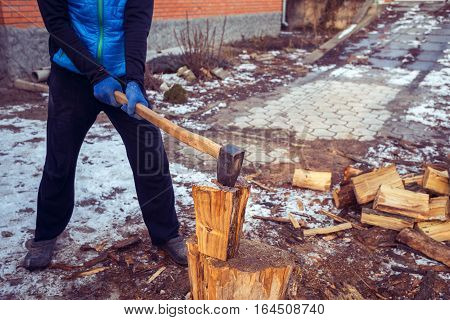 Man With A Axe In His Hand In The Process Of Cutting Wood