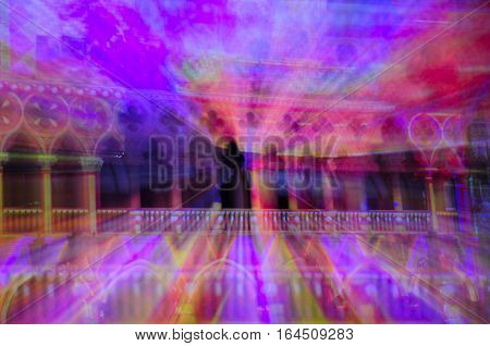an Abstract image of lights streaks coming from a christmas holiday display on the island of macau lit up at night with lights in Asia