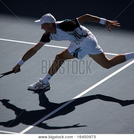 MELBOURNE, AUSTRALIA - JANUARY 27: Nikolay Davydenko in action at his quarter final loss to Roger Federer during the 2010 Australian Open on January 27, 2010 in Melbourne, Australia