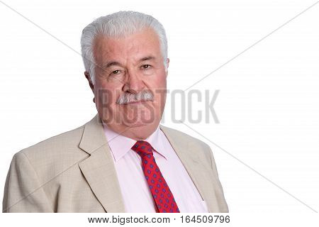 Mature Businessman In Cream Suit