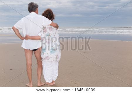 A Couple In Love Back On The Beach