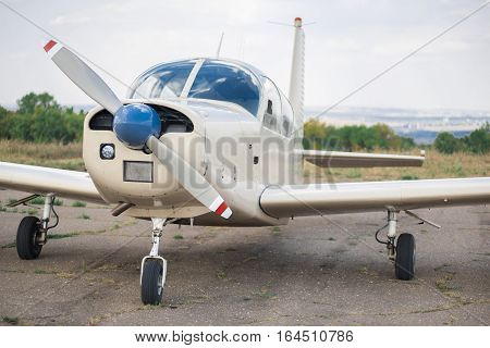 Propeller plane parking at the airport. Small airplane. Front view. poster