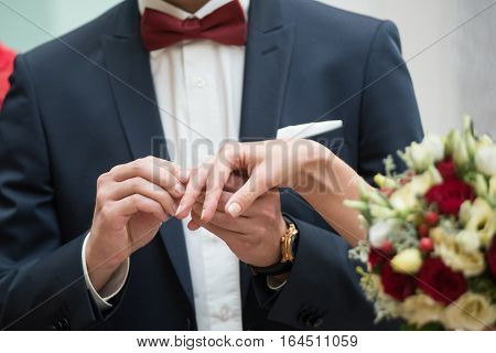 Bride And Groom Are Changing Rings On Wedding