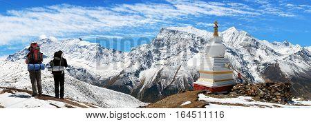 Panoramic view of Annapurna 2 II 3 III 4 IV Ganggapurna and Khangsar Kang from Ice Lake buddhist stupa and tourists way to Thorung La pass Annapurna circuit trek Nepal