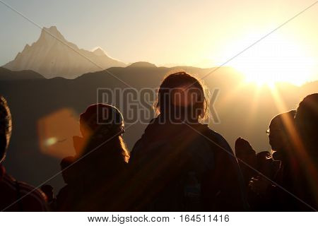 Peope in the mountains of Himalayas  in the morning sunrise