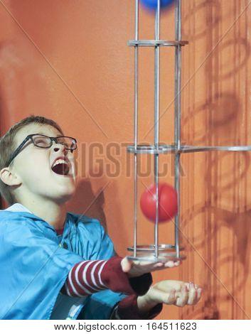 LAS VEGAS, NEVADA, DECEMBER 29. The Discovery Children's Museum on December 29, 2016, in Las Vegas, Nevada. A Boy Tries to Catch a Ball at the Discovery Children's Museum in Las Vegas, Nevada.