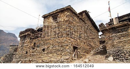View of local stony building in Upper Pisang village one of the best villages in round Annapurna circuit trekking trail route Manang area Nepal