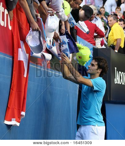 MELBOURNE - JANUARY 27: Roger Federer signs autographs after his win over Nikolay Davydenko during a quarter final match in the 2010 Australian Open on January 27, 2010 in Melbourne