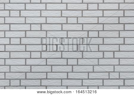 White bricks wall seamless background or texture