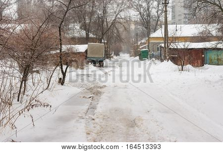 DNEPROPETROVSK UKRAINE - JANUARY 18, 2016: Small street in suburb of the Dnepropetrovsk city at snowy January 18, 2016 day