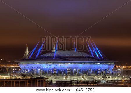 Saint-Petersburg Russia - December 28 2016: Night illumination FIFA World Cup host stadium Football stadium lit up at night.
