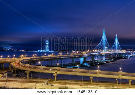 Saint-Petersburg Russia - December 28 2016: Cable-stayed bridge across the Petrovsky waterway as part of the Western High-Speed Diameter of St. Petersburg illumination at night.