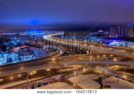 Saint-Petersburg Russia - December 29 2016: Top view of the city at night road transport interchange of the expressway and the football stadium.