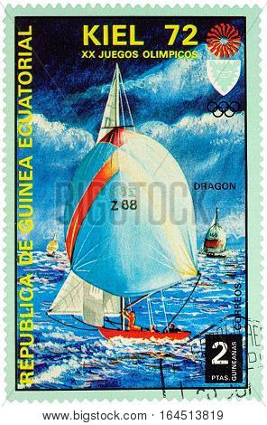 MOSCOW RUSSIA - January 09 2017: A stamp printed in Equatorial Guinea shows yachting the race in Dragon class series