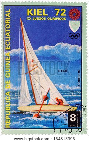 MOSCOW RUSSIA - January 09 2017: A stamp printed in Equatorial Guinea shows yachting the race in Star class series
