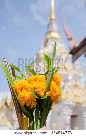 flower with incense stick and candles for worship Buddha in temple