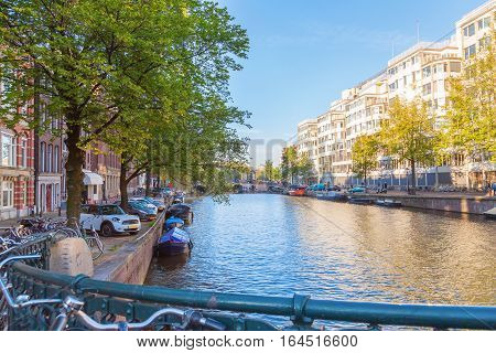 Landscape of house and boat in Amsterdams city The Netherlands