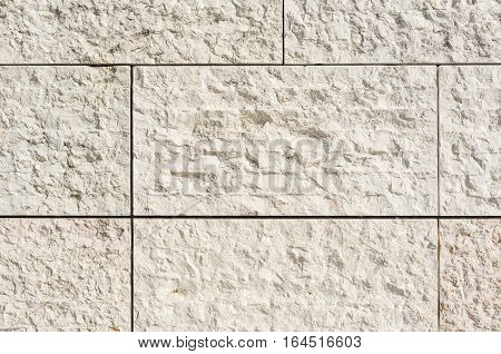 Bright stone facade, background texture of natural stone