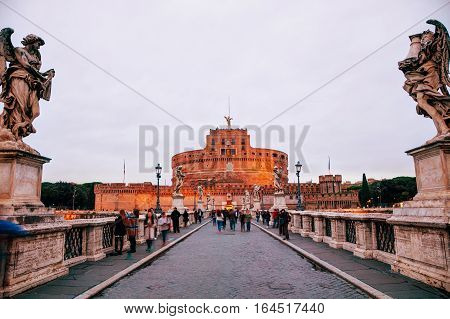 ROME - NOVEMBER 07: The Mausoleum of Hadrian (Castel and Ponte Sant'Angelo) with people on November 7 2016 in Rome Italy.
