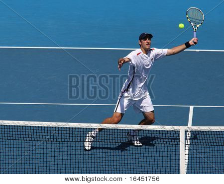 MELBOURNE, AUSTRALIA - MARCH 6: Carsten Ball of Australia hits a volley in the doubles rubber of the Davis Cup tie against Chinese Taipei on March 6, 2010 in Melbourne, Australia