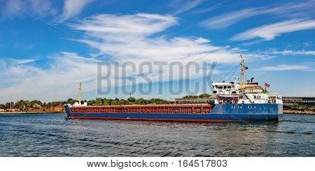 A cargo ship leaving port of Gdansk Poland.