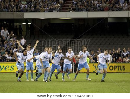 MELBOURNE - MARCH 20: Sydney FC players celebrate their A-League grand final win over Melbourne Victory on March 20, 2010 in Melbourne